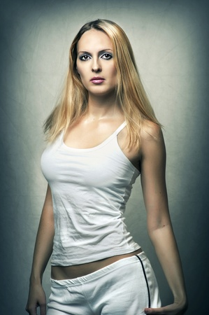Sexy female underwear model. Young beautiful blond fit woman with white cotton t-shirt and panties (or sports shorts) Stock Photo - 10941080