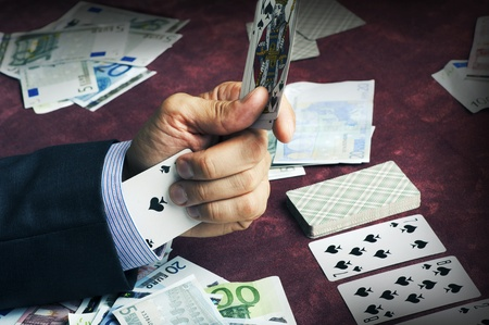 cheated: One ace of Spades in the sleeve. Male hand closeup - cardsharper poker gamer