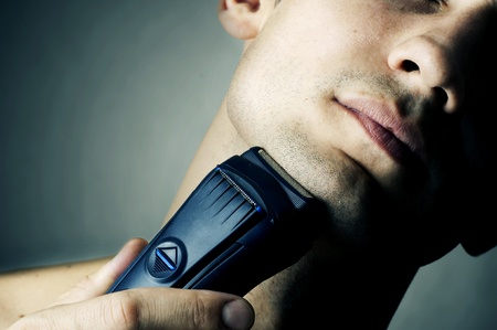 1 man only: Fashion portrait of male chin and electric shaver  Stock Photo