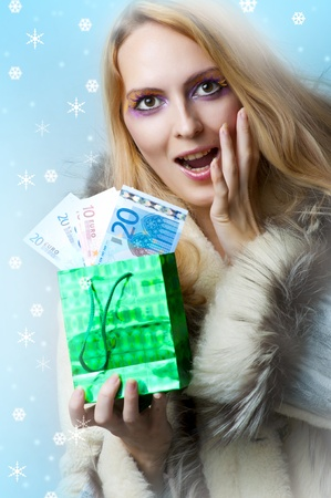 Fashion portrait of young beautiful woman winner holding money - 50 (fifty) euro. Stock Photo - 11015483