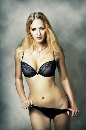 Fashion portrait of sexy fit underwear model. Young woman wearing black lacy bikini Stock Photo - 11015482