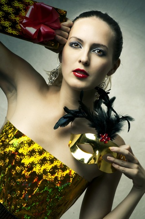 Fashion portrait of young glamour beautiful female model. Style and make up for christmas party photo