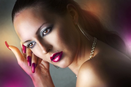 Fashion beauty portrait of young glamour model woman with long purple nails add sexy lips with lip-glow closeup Stock Photo