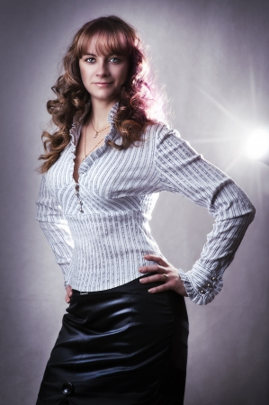 Fashion portrait of young business woman in white blouse and black skirt photo