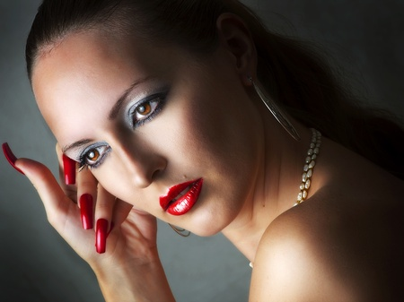 Fashion beauty portrait of young glamour model woman with long purple nails add sexy lips with lip-glow closeup photo