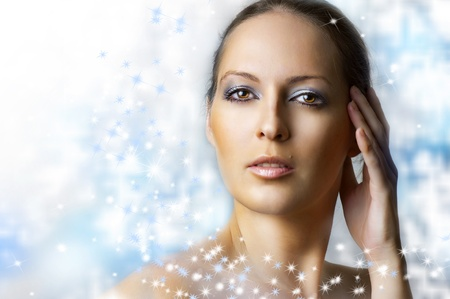 Winter natural beauty make up - frozen queen. Portrait of young sexy woman with perfect healthy skin on blur christmas background Stock Photo - 11241248