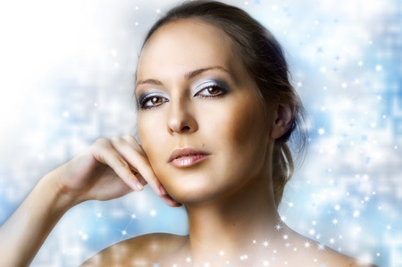 Winter natural beauty make up - frozen queen. Portrait of young sexy woman with perfect healthy skin on blur christmas background photo