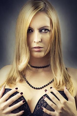 Fashion portrait of young sexy woman in black lace bra, beads and with long healthy hair and glamour hairstyle photo