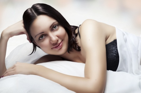 black bra: Beauty portrait of beautiful woman. Morning in white bed. Sexy female model in black bra at bedroom