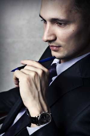 male fashion: Fashion portrait of successful confident business man with chronographs at hand  Stock Photo