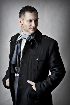 overcoat: Fashion portrait of handsome young man model in black coat for autumn and spring Stock Photo