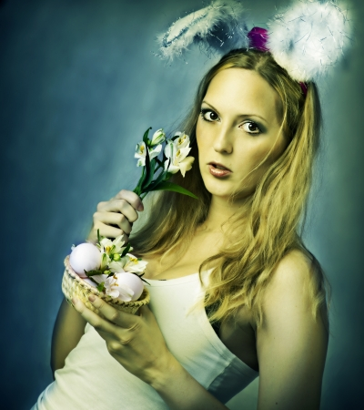 Sexy woman - easter bunny with little basket of eggs photo