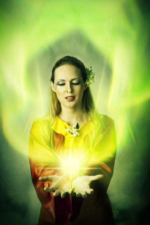 Young woman elf or witch making magic. Fantasy portrait Stock Photo