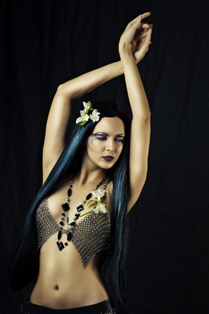 Young sexy woman dancing belly dance on black background Stock Photo - 12120702