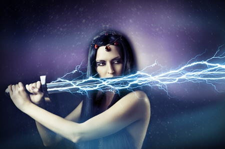 dark elf: Fashion portrait of young sexy brunette woman - storm. Weather - flash lightning on her sword. mythology, fairytale or fantasy world. Stock Photo
