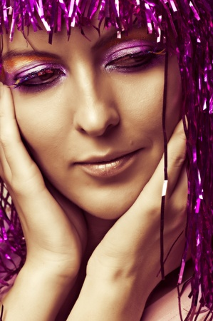 Fashion portrait of young sexy woman face with creative evening make-up and multicolored false eyelashes photo
