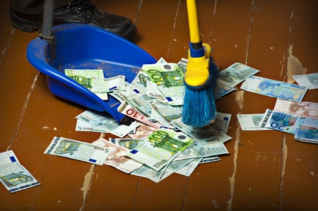 Person sweeping euro money banknotes with a broom to scoop Stock Photo - 12390523