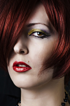 Fashion portrait of beauty young woman with sexy red lips; bright make-up and creative hairstyle photo