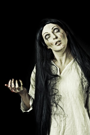 dracula woman: Portrait of a gory bloody and scary zombie woman on black background Stock Photo