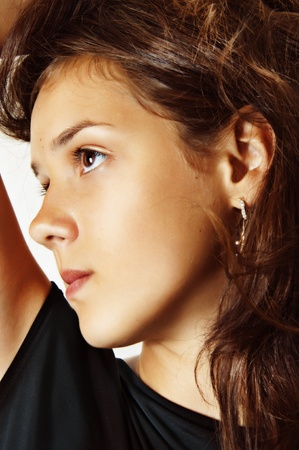 teen girl brown hair: Fashion portrait of young teenage girl face closeup with natural make-up Stock Photo