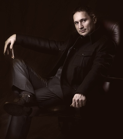 Fashion retro portrait of handsome fashionable man in coat and suit photo