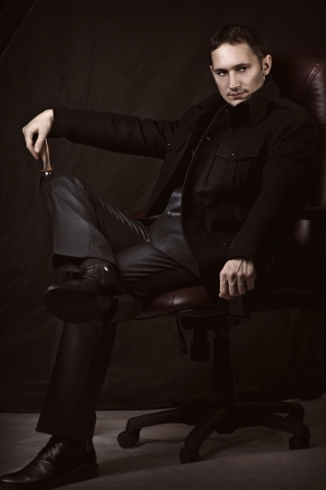 cane chair: Fashion retro portrait of handsome fashionable man in coat and suit