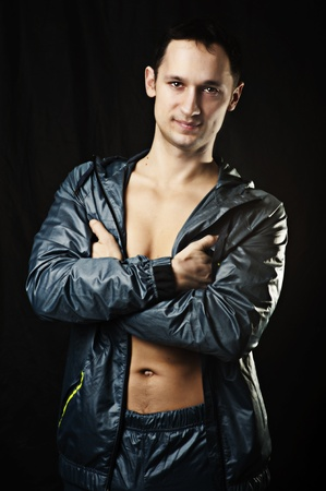 Portrait of young sexy man in sport wear. Fitness Center Instructor concept photo