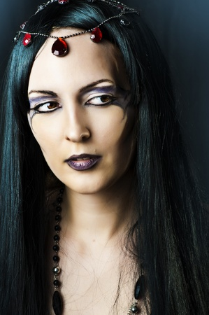 witch face: Closeup glamor portrait of young beautiful woman with long black hair