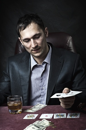Young adult handsome business man winner playing poker photo