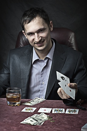 croupier: Young adult handsome business man winner playing poker