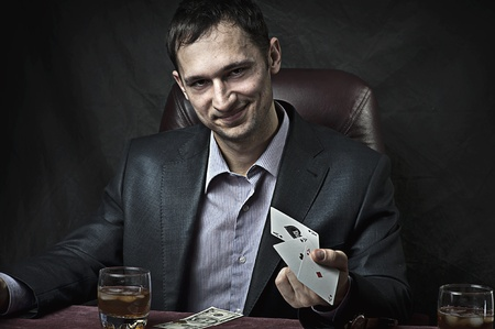 Young adult handsome business man winner playing poker Stock Photo - 12390543