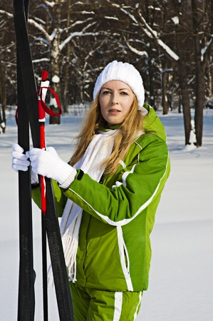 Woman skyer in snow forest photo