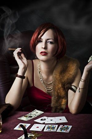 fortune: Fashion portrait of young adult woman with red hair in retro style - 30s,50s, 40s years. Player poker or fortune teller