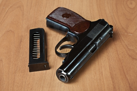 Handgun on the table with holster, belt and empty pistol holder Stock Photo - 12718581