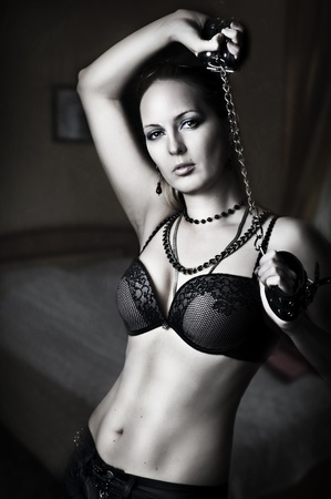 Portrait of sexy lady - mistress with handcuffs on a chain Stock Photo - 12716552