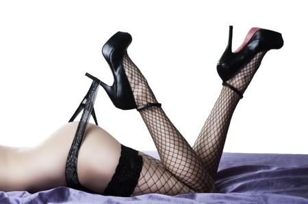 sexy legs stockings: Sexy female buttocks and legs in high heel black shoes and stockings Stock Photo