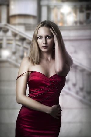 Luxury blond woman in red dress inside Stock Photo - 12728066
