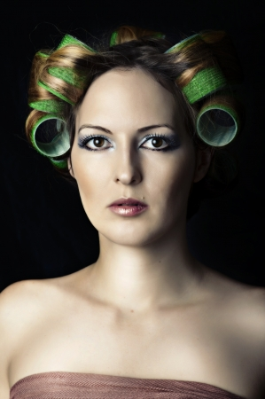 curlers: Young beautiful woman with hair rools oh her head