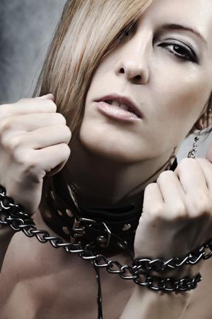esclavo: Sexy mujer con cadena y collar Foto de archivo
