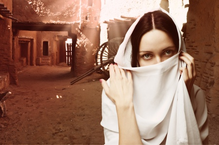 headscarf: Mystery woman with white veil on face, traditional east costume