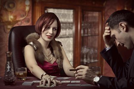 Luxury life. Poker players - rich woman winner photo