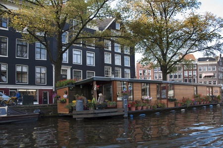 Amsterdam canals in  autumn weather. View from water