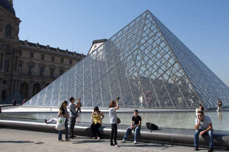 PARIS - SEPTEMBER 29, 2011. Glass Pyramid and tourists at the Louvre Museum on September 29, 2011.  Stock Photo - 13140837