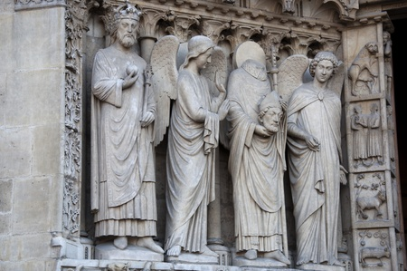 Detail of gothic Cathedral of Notre Dame in Paris  Statues Stock Photo - 13172995