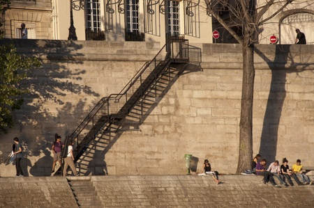 PARIS - SEPTEMBER 29: People on bank By the Seine of Paris on September 29, 2011 in Paris. Stock Photo - 13141500