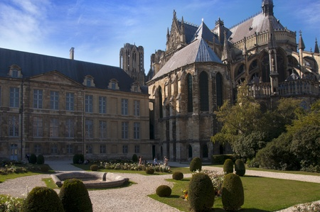 champagne region: Back side of Reims Notre Dame Cathedral and garden, Champagne region France
