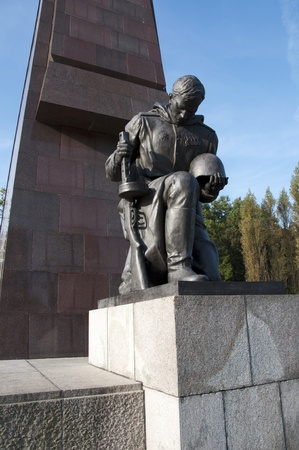 military cemetery: Huge statue of a kneeling soldier at the Soviet War Memorial in Treptower Park in Berlin, Germany  Editorial