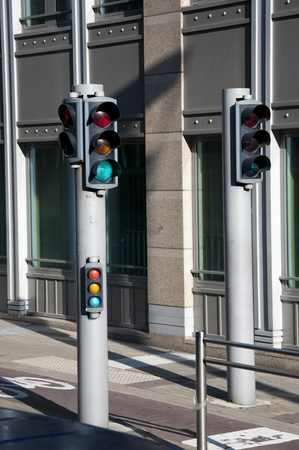 View of traffic lights for bicycles, people and car in Brussels, belgium photo
