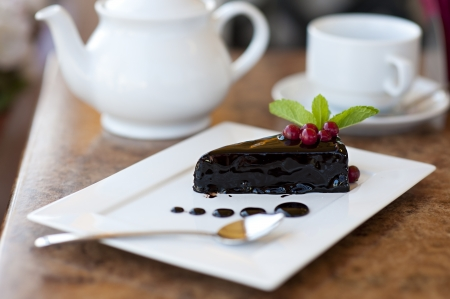 coated: chocolate cake on a plate. Dessert with tea Stock Photo