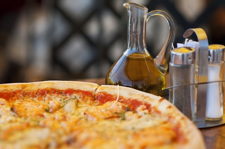 ovenbaked: pizza and olive oil on restaurant table